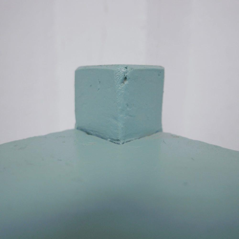 mint-blauwe hoekkast