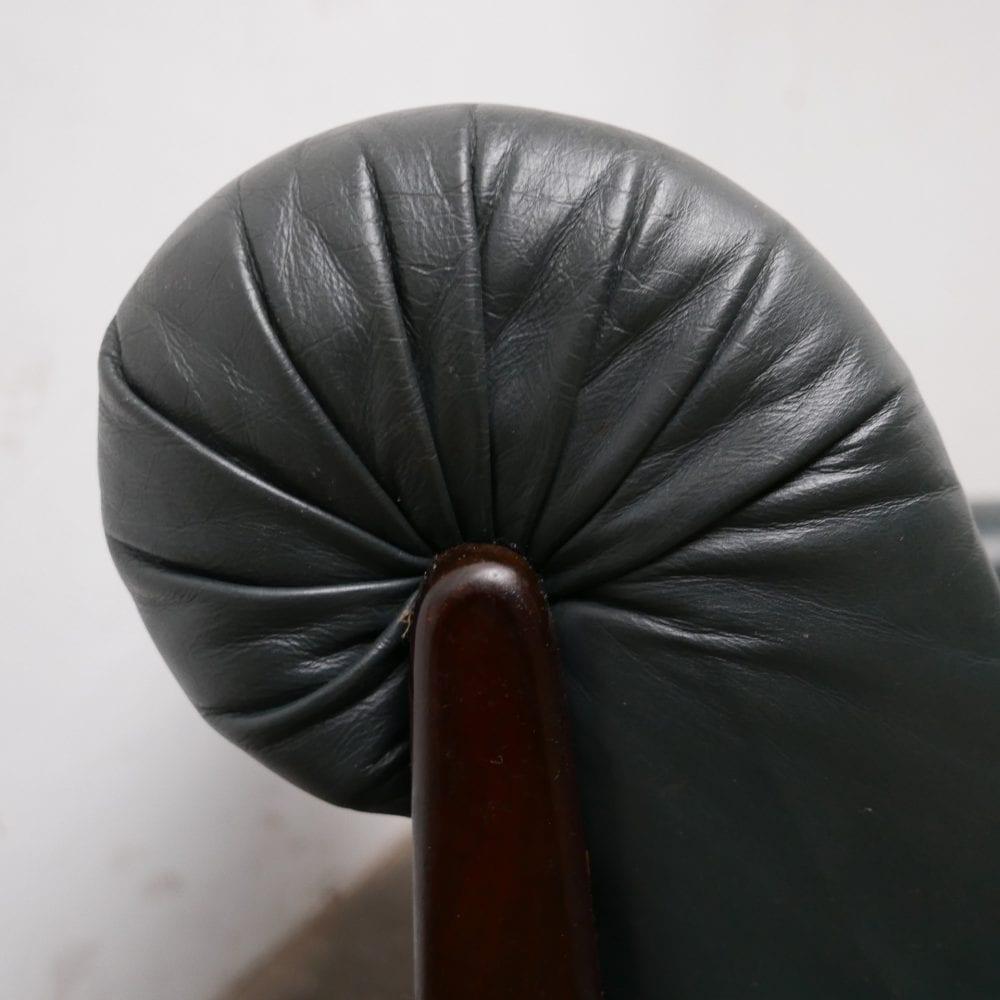 Donkergroen leren fauteuil