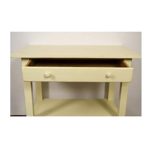 gele eettafel met onderblad