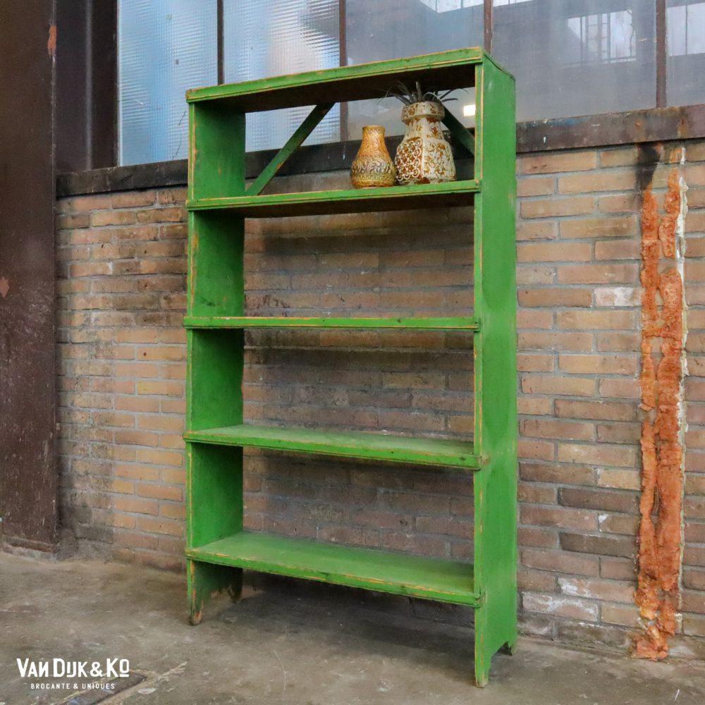 Groene boekenkast open kast