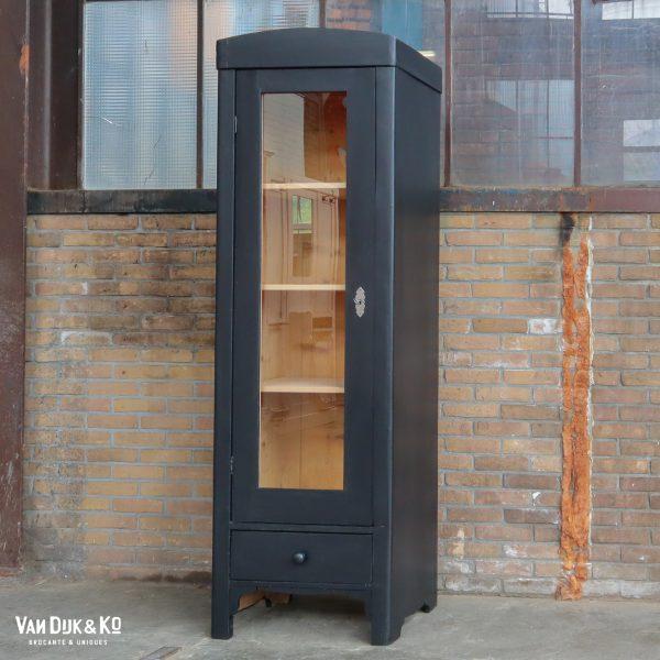 Zwarte eendeurs vitrinekast