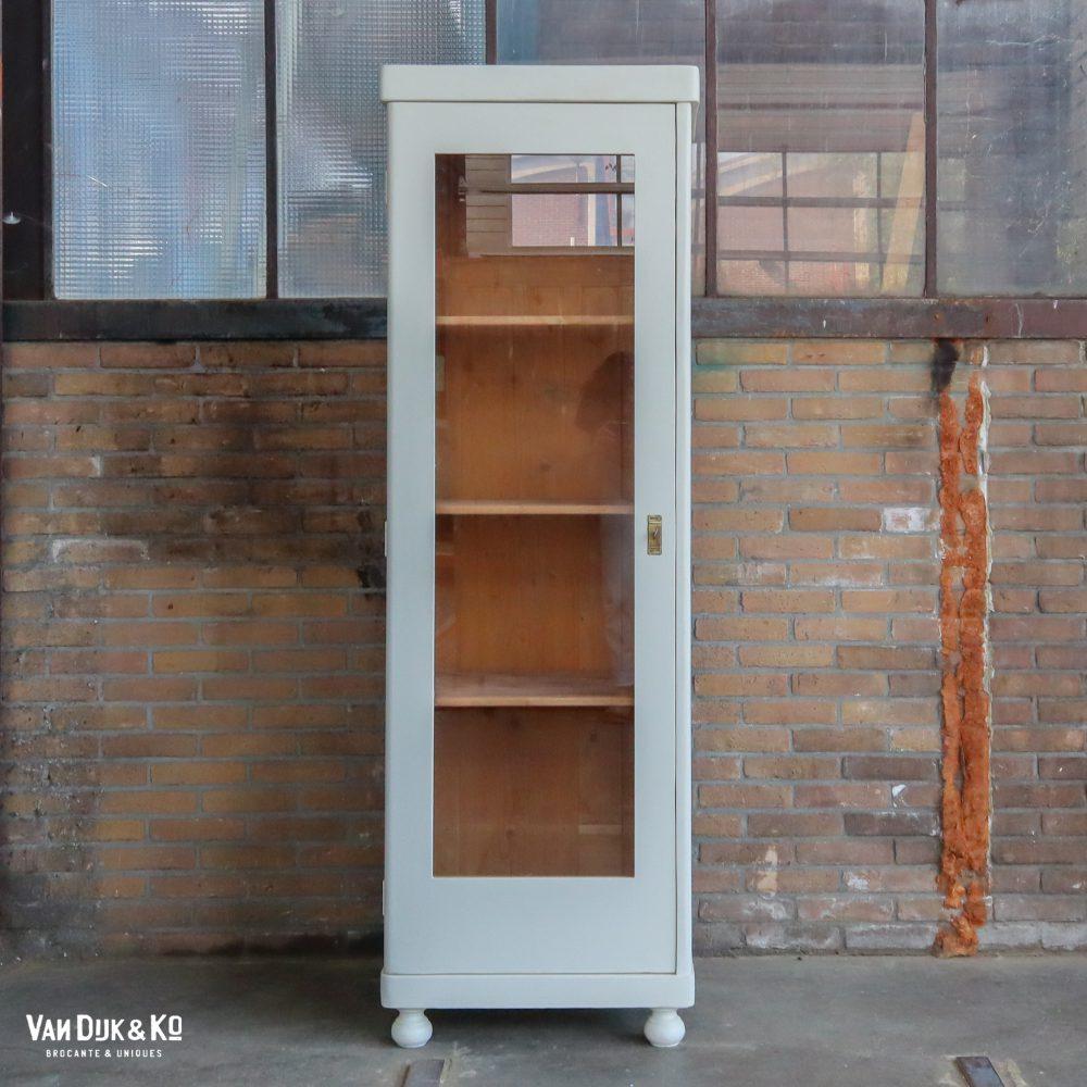 Witte eendeurs vitrinekast